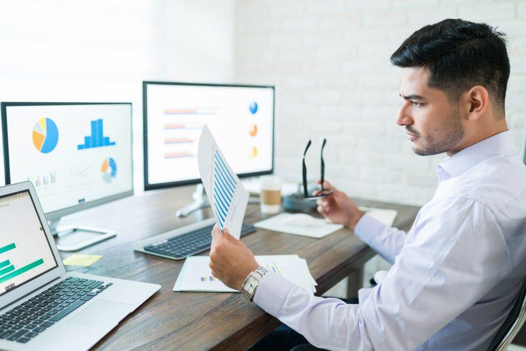 Businessman Examining Sales Data