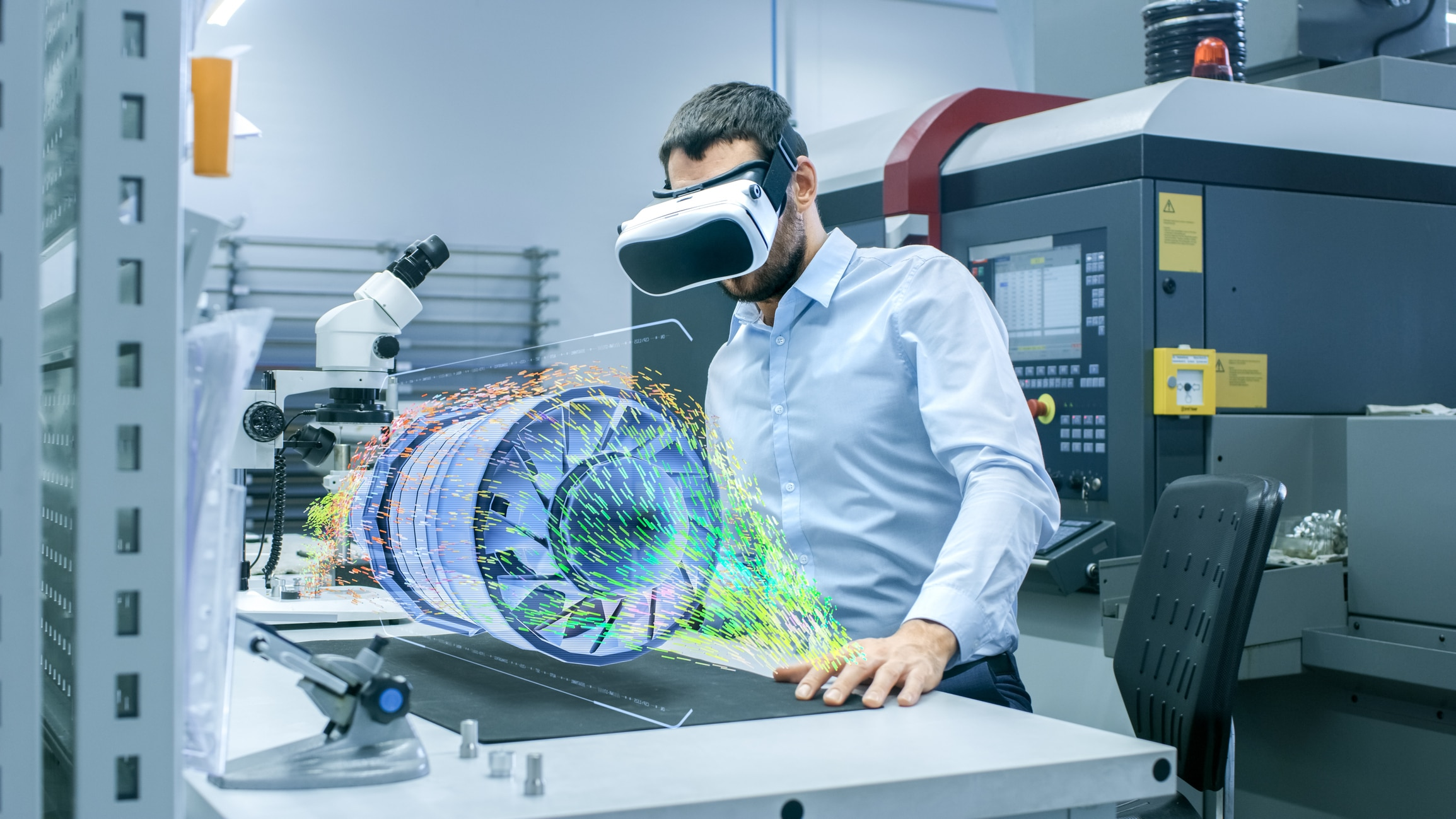 Factory Chief Engineer Wearing VR Headset Designs Engine Turbine on the Holographic Projection Table. Futuristic Design of Virtual Mixed Reality Application. virtual reality for training